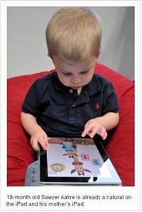 toddler using an iPad
