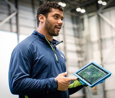 Russell Wilson,  the starting QB of the Seattle Seahawks, with the Microsoft Surface Pro