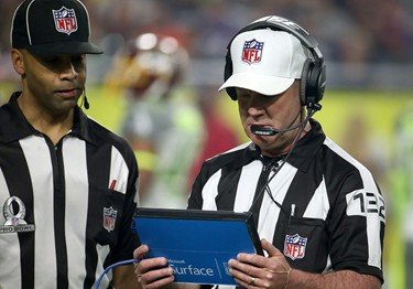 NFL Referees with Surface tablet
